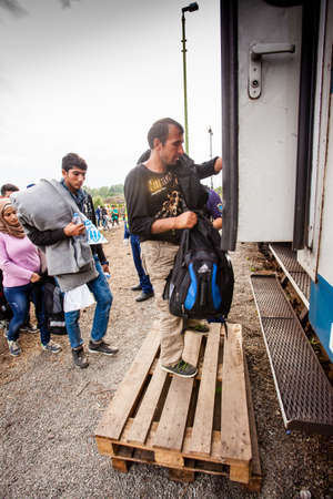 assad: GYEKENYES- OCTOBER 5 : War refugees at the Gyekenyes Zakany Railway Station on 5 October 2015 in Gyekenyes, Hungary. Refugees are arriving constantly to Hungary on the way to Germany. Editorial