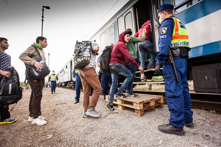 poorness: GYEKENYES- OCTOBER 5 : War refugees at the Gyekenyes Zakany Railway Station on 5 October 2015 in Gyekenyes, Hungary. Refugees are arriving constantly to Hungary on the way to Germany. Editorial
