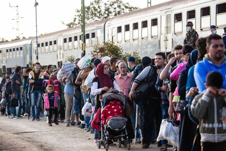 middle east crisis: GYEKENYES- OCTOBER 5 : War refugees at the Gyekenyes Zakany Railway Station on 5 October 2015 in Gyekenyes, Hungary. Refugees are arriving constantly to Hungary on the way to Germany. Editorial
