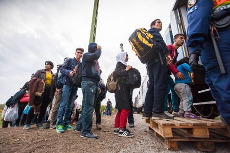 assad: GYEKENYES- OCTOBER 6 : War refugees at the Gyekenyes Zakany Railway Station on 6 October 2015 in Gyekenyes, Hungary. Refugees are arriving constantly to Hungary on the way to Germany. Editorial