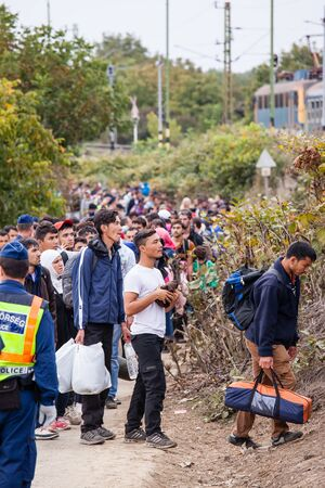 poorness: GYEKENYES- OCTOBER 6 : War refugees at the Gyekenyes Zakany Railway Station on 6 October 2015 in Gyekenyes, Hungary. Refugees are arriving constantly to Hungary on the way to Germany. Editorial