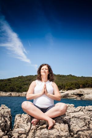 pregnant woman yoga: beautiful pregnant woman relaxing in yoga pose