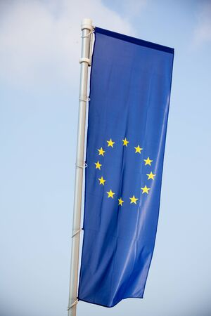 european economic community: European Union flag on blue sky background