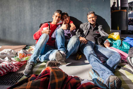 BUDAPEST - SEPTEMBER 7: war refugees waiting for train at Keleti Railway Station on 7 September 2015 in Budapest, Hungary. Refugees are arriving constantly to Hungary on the way to Germany.