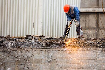 pecs: PECS - DECEMBER 10 : Demolishing the 25 floor building on 10 December 2015 in Pecs, Hungary. The 25 floor building is the highest unpeopled building in Europa