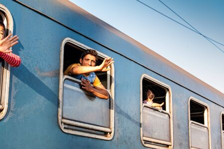 iraqi: GYEKENYES- OCTOBER 5 : War refugees at the Gyekenyes Zakany Railway Station on 5 October 2015 in Gyekenyes, Hungary. Refugees are arriving constantly to Hungary on the way to Germany. Editorial