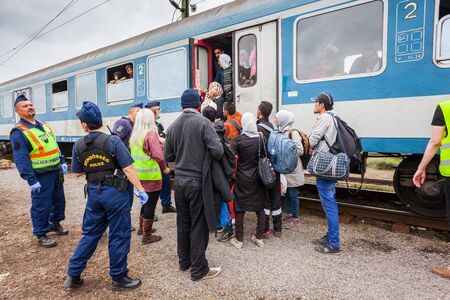 terrorism crisis: GYEKENYES- OCTOBER 6 : War refugees at the Gyekenyes Zakany Railway Station on 6 October 2015 in Gyekenyes, Hungary. Refugees are arriving constantly to Hungary on the way to Germany. Editorial