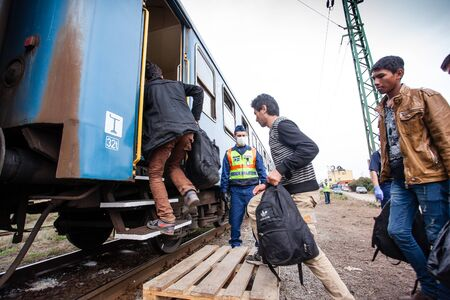 GYEKENYES- OCTOBER 6 : War refugees at the Gyekenyes Zakany Railway Station on 6 October 2015 in Gyekenyes, Hungary. Refugees are arriving constantly to Hungary on the way to Germany. Editorial