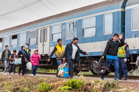 iraqi: GYEKENYES- OCTOBER 6 : War refugees at the Gyekenyes Zakany Railway Station on 6 October 2015 in Gyekenyes, Hungary. Refugees are arriving constantly to Hungary on the way to Germany. Editorial