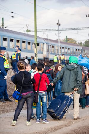 GYEKENYES- OCTOBER 5 : War refugees at the Gyekenyes Zakany Railway Station on 5 October 2015 in Gyekenyes, Hungary. Refugees are arriving constantly to Hungary on the way to Germany. Editorial