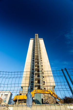 unsettled: PECS - DECEMBER 10 : Demolishing the 25 floor building on 10 December 2015 in Pecs, Hungary. The 25 floor building is the highest unpeopled building in Europa