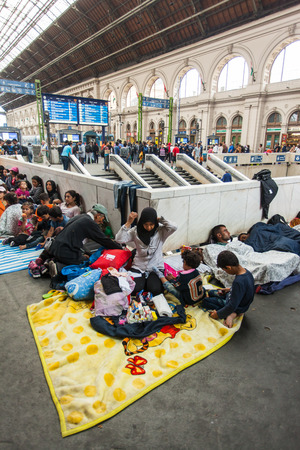 middle east crisis: BUDAPEST - SEPTEMBER 4 :Transit zone at the Keleti Railway Station for war refugees on 4 September 2015 in Budapest, Hungary. Refugees are arriving constantly to Hungary on the way to Germany.