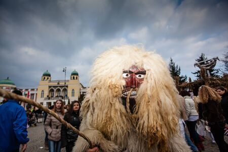 public celebratory event: MOHACS, HUNGARY - FEBRUARY 17: Unidentified people in mask participants at the Mohacsi Busojaras, it is a carnival for spring greetings) February 17, 2015 in Mohacs, Hungary.
