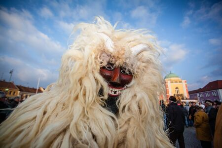 MOHACS, HUNGARY - FEBRUARY 17: Unidentified people in mask participants at the Mohacsi Busojaras, it is a carnival for spring greetings) February 17, 2015 in Mohacs, Hungary.