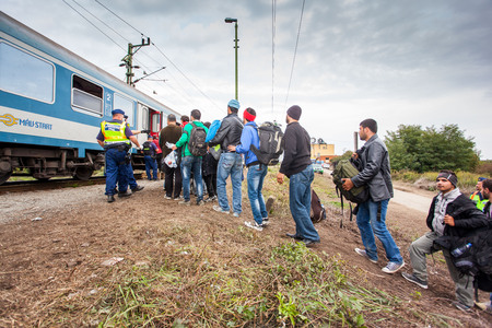 assad: GYEKENYES- OCTOBER 6 : War refugees at the Gyekenyes Zakany Railway Station on 6 October 2015 in Gyekenyes, Hungary. Refugees are arriving constantly to Hungary on the way to Austria.