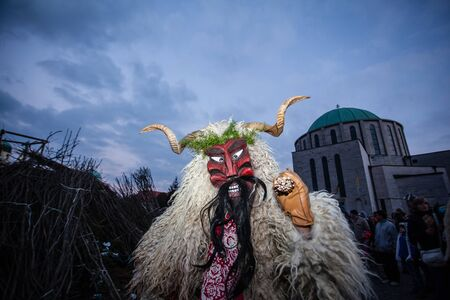 traditonal: MOHACS, HUNGARY - FEBRUARY 17: Unidentified people in mask participants at the Mohacsi Busojaras, it is a carnival for spring greetings) February 17, 2015 in Mohacs, Hungary.