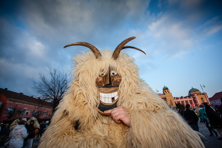 traditonal: MOHACS, HUNGARY - FEBRUARY 17: Unidentified people in mask participants at the Mohacsi Busojaras, it is a carnival for spring greetings February 17, 2015 in Mohacs, Hungary.