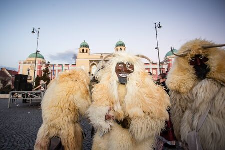 mohacs: MOHACS, HUNGARY - FEBRUARY 4: Unidentified people in mask participants at the Mohacsi Busojaras, it is a carnival for spring greetings) February 4, 2016 in Mohacs, Hungary. Editorial