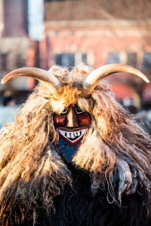 mohacs: MOHACS, HUNGARY - FEBRUARY 4: Unidentified people in mask participants at the Mohacsi Busojaras, it is a carnival for spring greetings February 4, 2016 in Mohacs, Hungary.