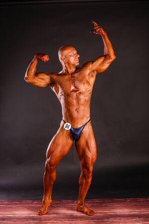 bodybuilder posing over black background Stock Photo
