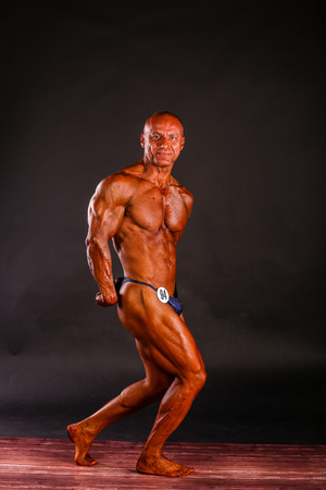 sixpacks: bodybuilder posing over black background Stock Photo
