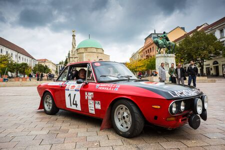 pecs: PECS - OCTOBER 7 : 50th Mecsek Rally starting at the Szechenyi Square in Pecs on 7 October 2016 in Pecs, Hungary. Mecsek Rally is a famous hungarian car race Editorial