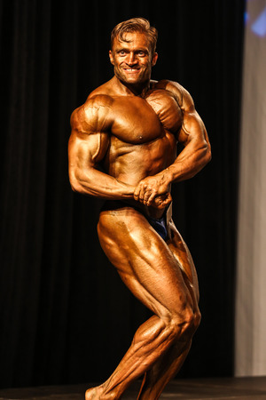 steroid: Bodybuilder posing on the stage Editorial