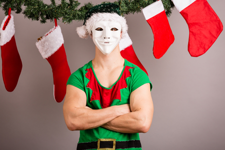 Funny Christmas elf in green suits and mask