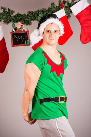 Funny Christmas elf in green suits Stock Photo