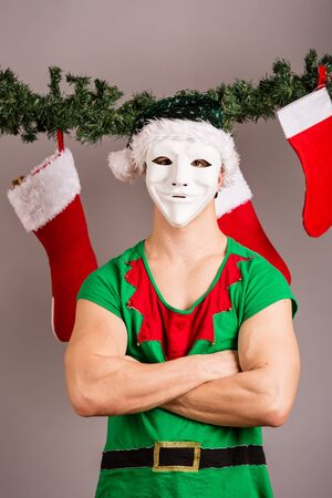 sexy xmas elf: Funny Christmas elf in green suits and mask