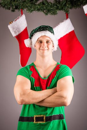 sexy xmas elf: Funny Christmas elf in green suits Stock Photo