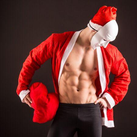 sexy santa claus: sexy santa claus wearing maskguy on black background