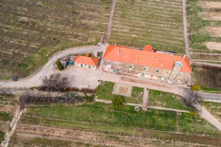 aerial view of vineyard with building