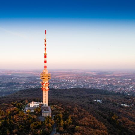 Big TV tower in forest Stock Photo