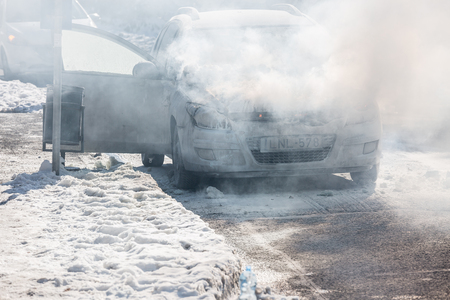 engine: PECS, HUNGARY - JANUARY 21: Burning Car on road Pecs in wintertime, Hungary on January 21, 2017.
