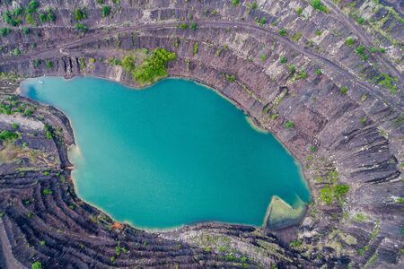 Aerial view, deep mine lake in place of a mining pit