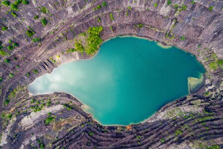 huge tree: Aerial view, deep mine lake in place of a mining pit