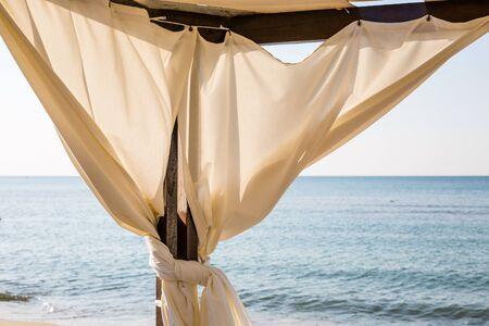 sunshade: White canopie on a beach