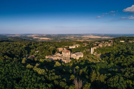 damaged roof: aerial view of abandoned mine tower in hungary