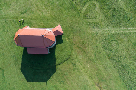 Wooden church with heart shape in grass