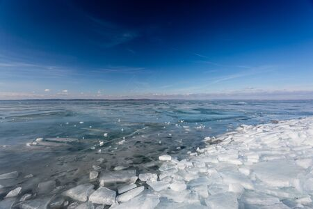 frozen lake Balaton with beautiful sky Stock Photo
