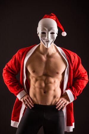 sexy santa claus wearing maskguy on black background