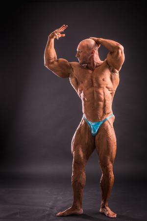 bodybuilder posing in studio Stock Photo