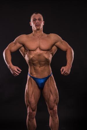 young bodybuider posing in studio Stock Photo