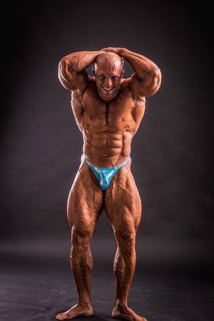 bodybuilder posing in studio 写真素材