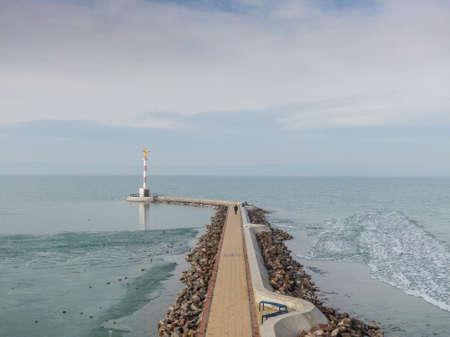 Icy Lake Balaton with pier in Siofok