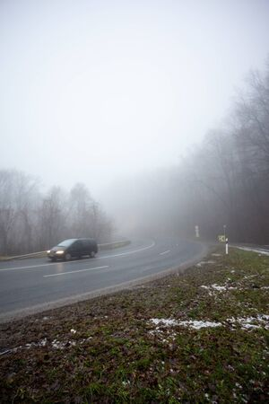 Moving car on highway with fog Stock Photo