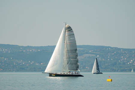 ZAMARDI - JULY 29: Sailing boats compete on the 52nd Blue Ribbon Championship at the Lake Balaton on 29 July 2020 in Zamardi, Hungary.