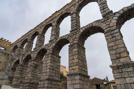 Partial view of the arches of the Roman Aqueduct of Segovia, in Spain. Archivio Fotografico - 131679486