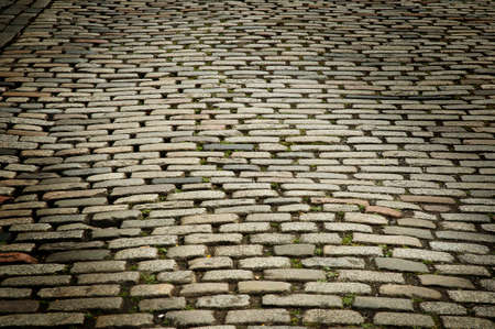 Old floor texture made with cobblestones in an Edinburgh street.